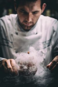 Chef served a gourmet smoking food